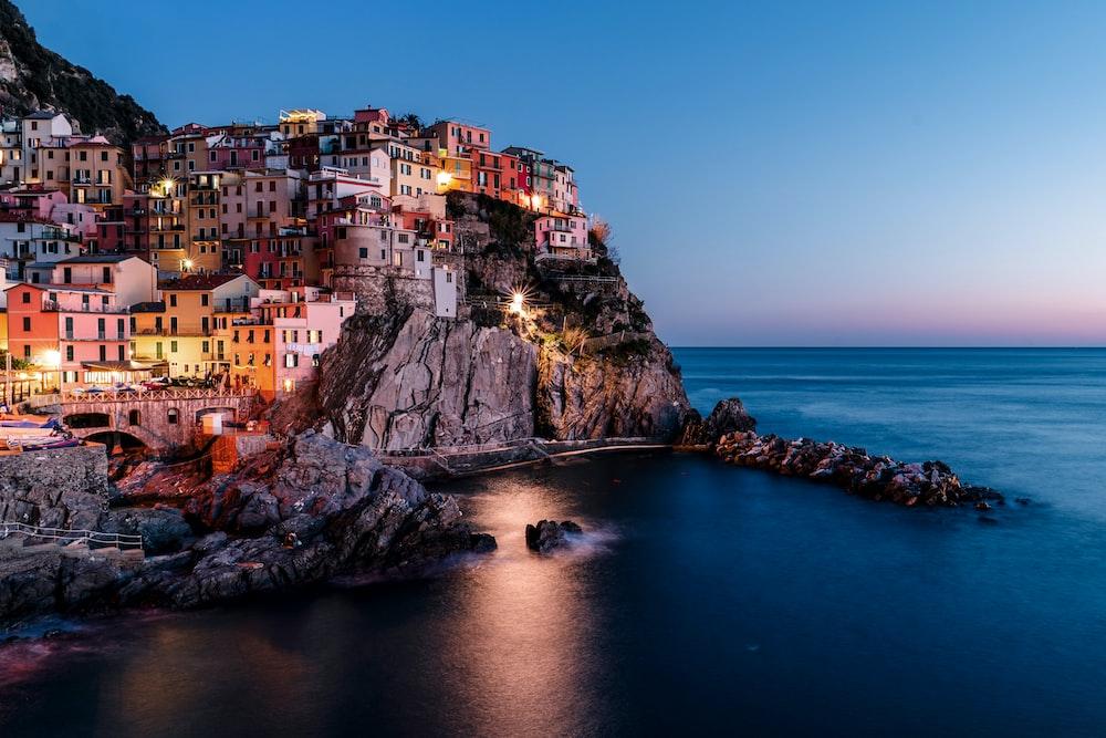 lighted houses near ocean