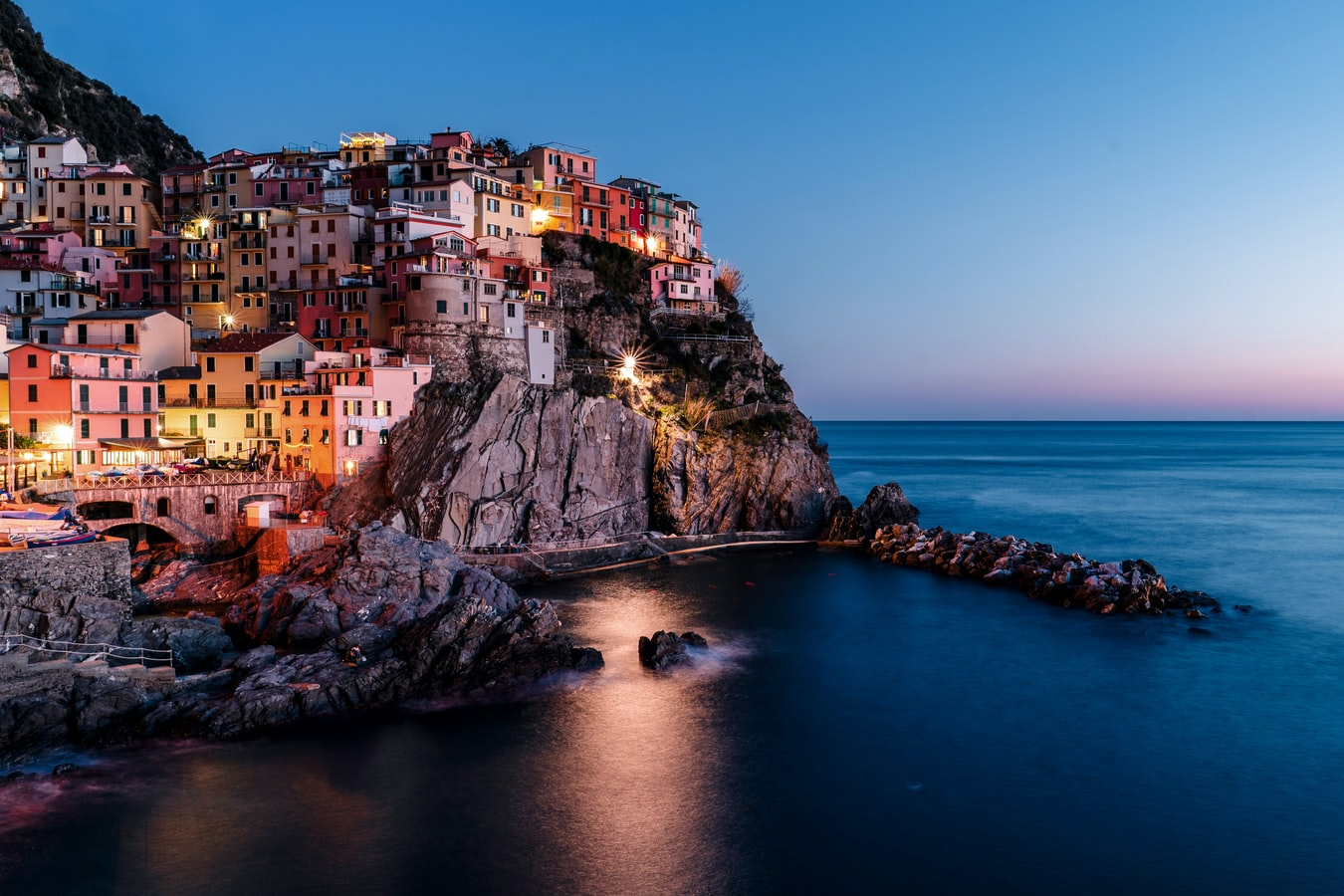 colorful homes dot the hillside in Cinque Terre, Italy