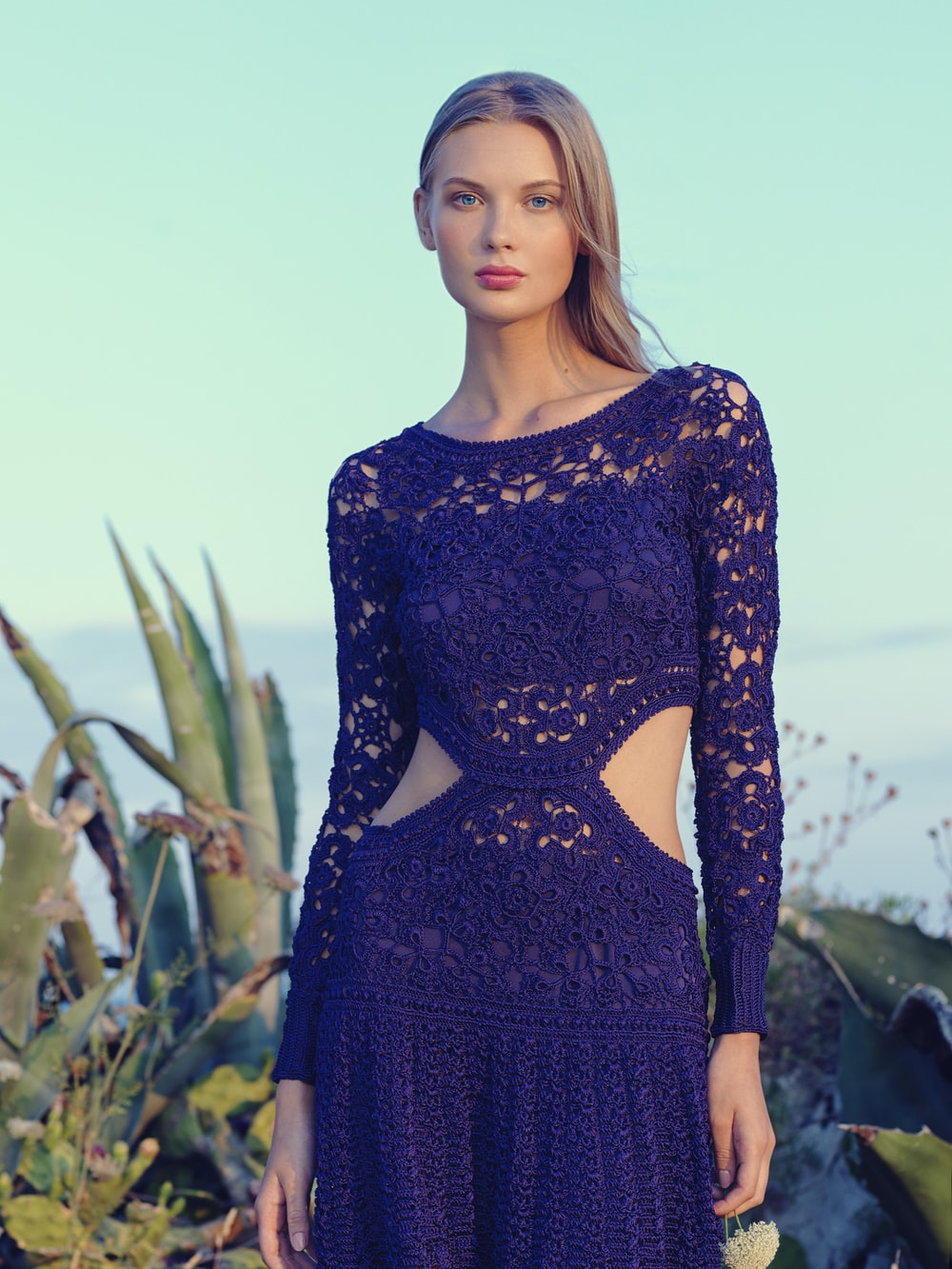 woman in purple lace knitted long-sleeved dress during daytime