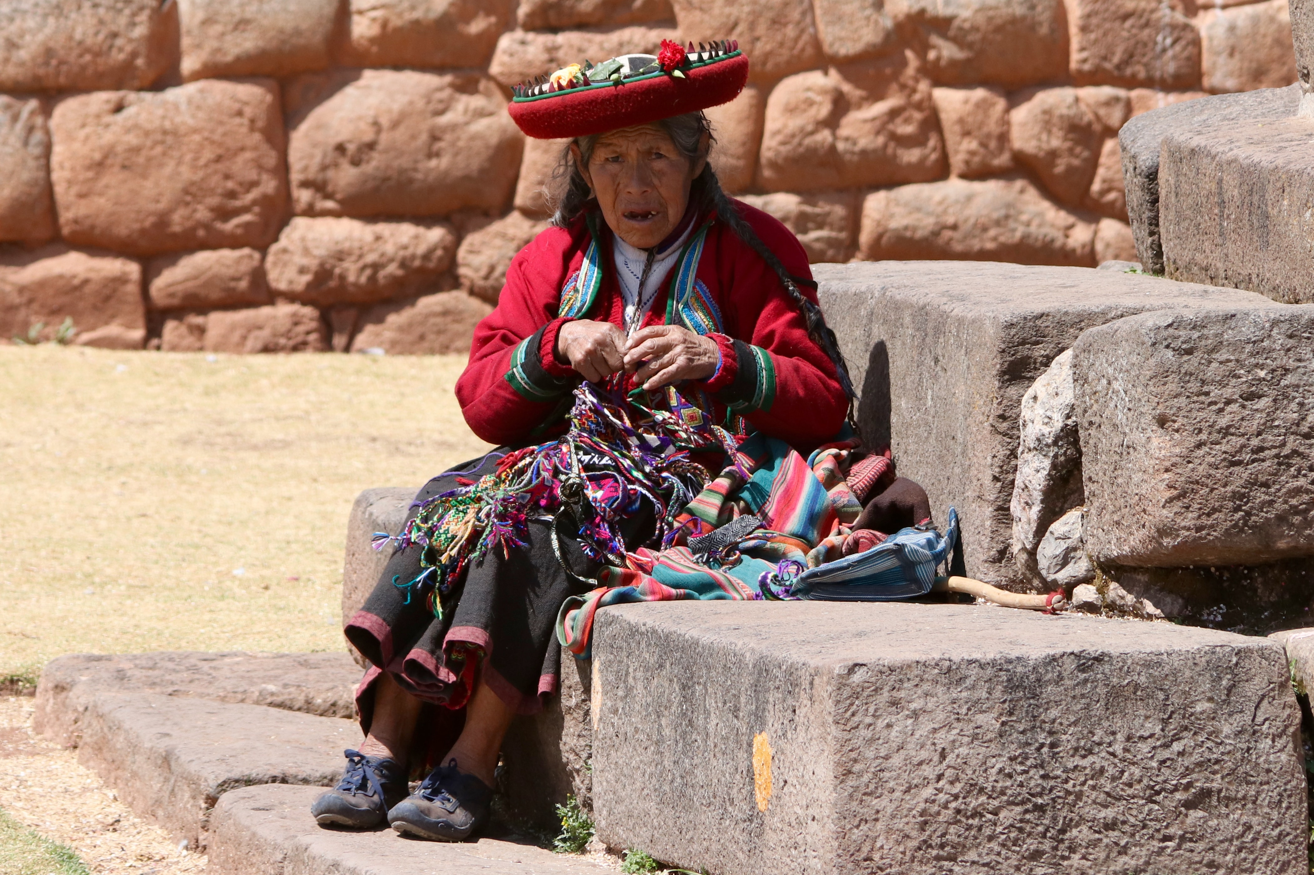 woman sitting on concrete staircase