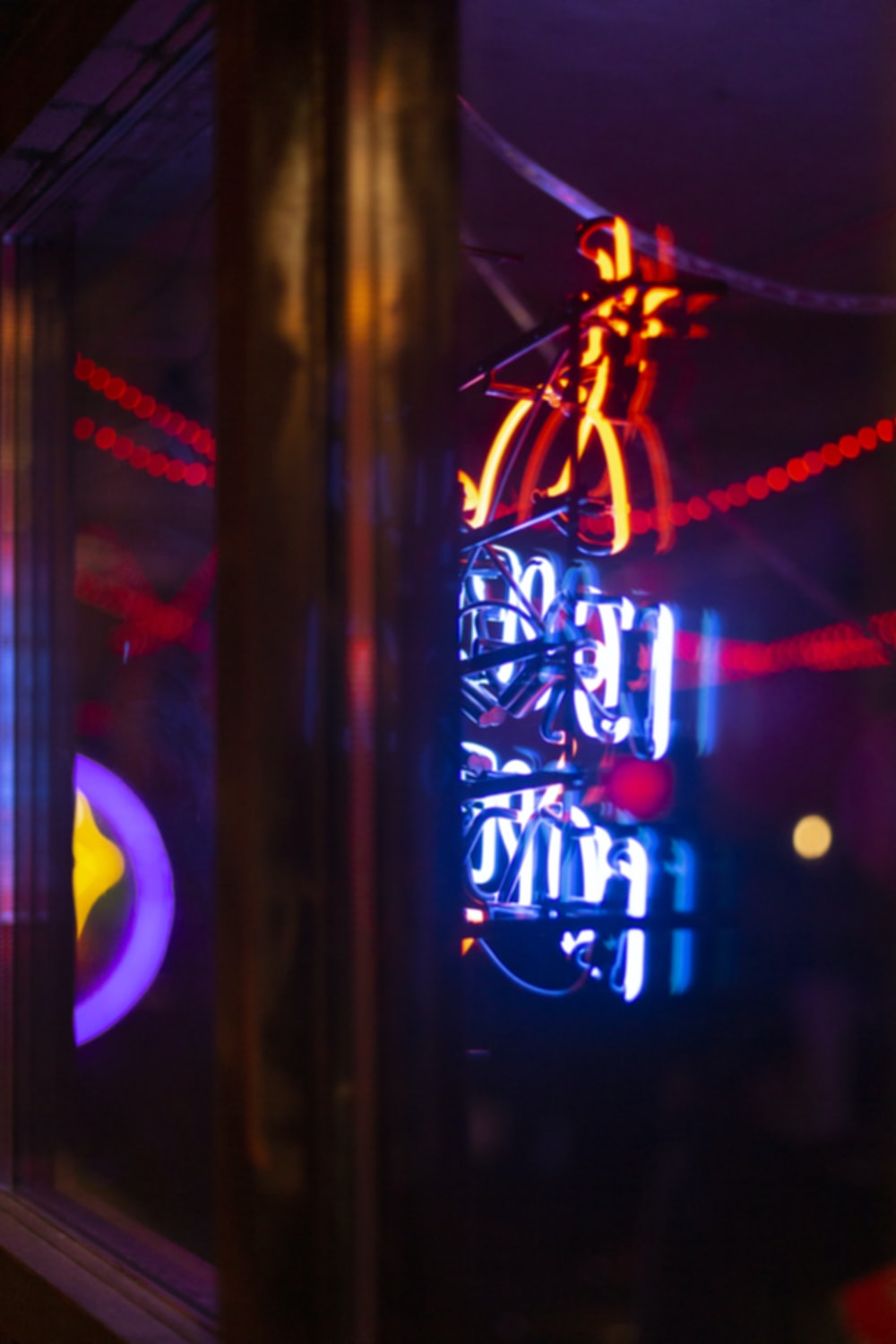 blue, red, and orange neon signage turned-on