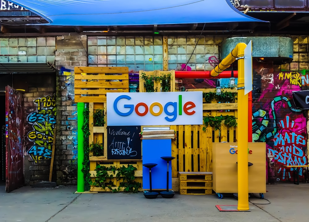 google logo beside building near painted walls at daytime