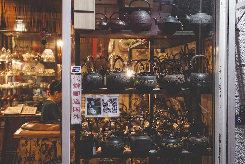 black teapots on shelf inside building