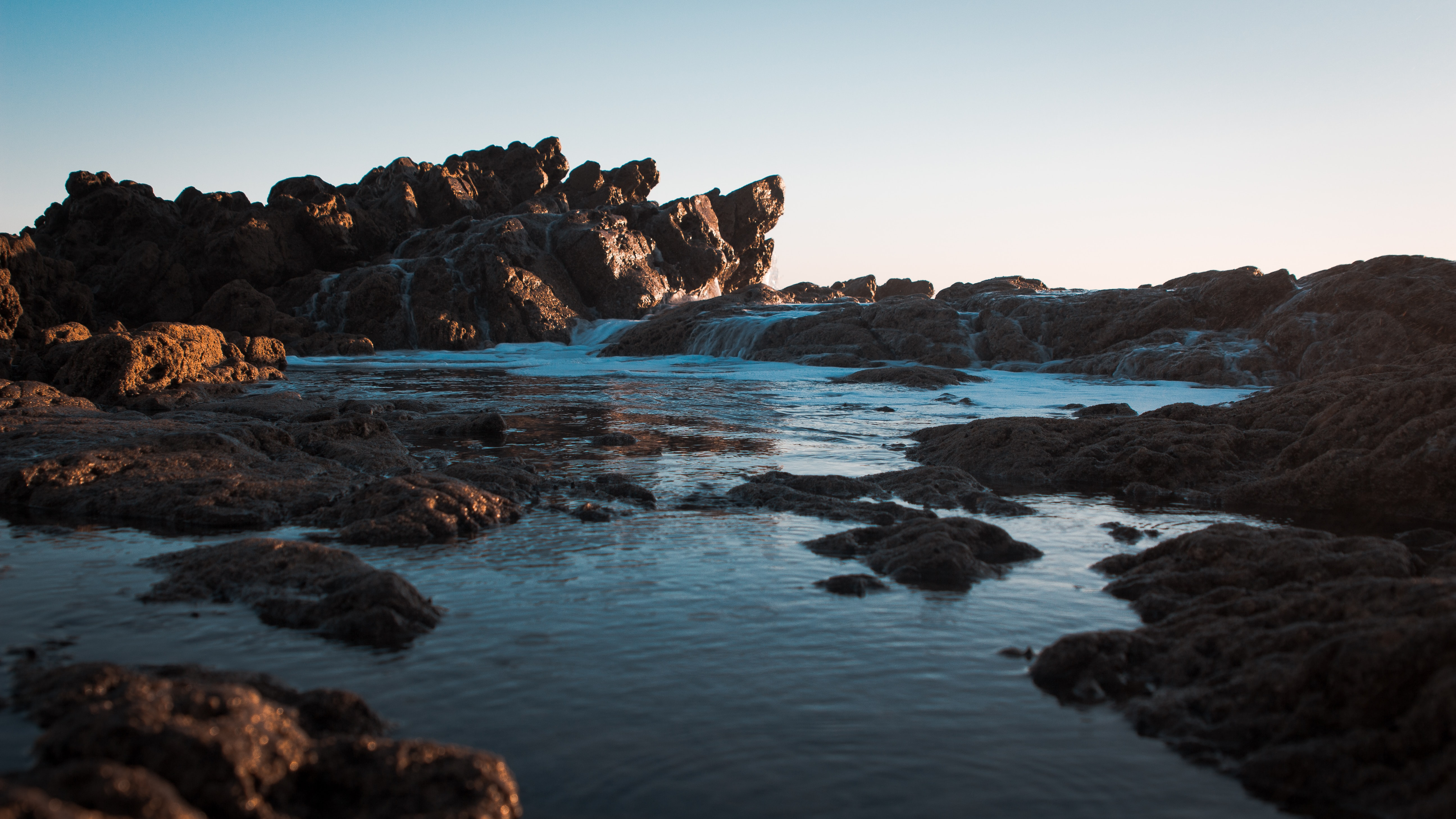 brown rocks and body of water