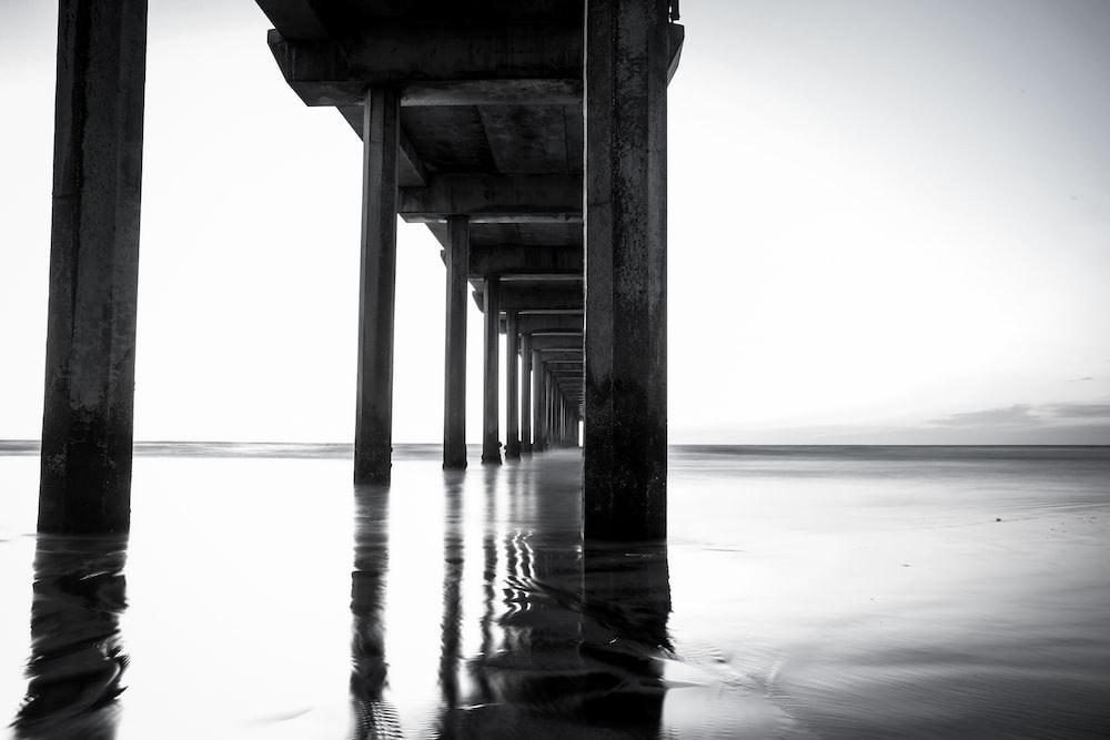 low-angle photography of concrete bridge
