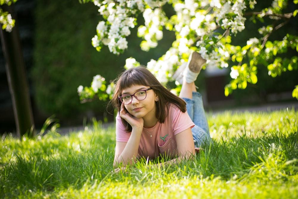 girl planking on grass