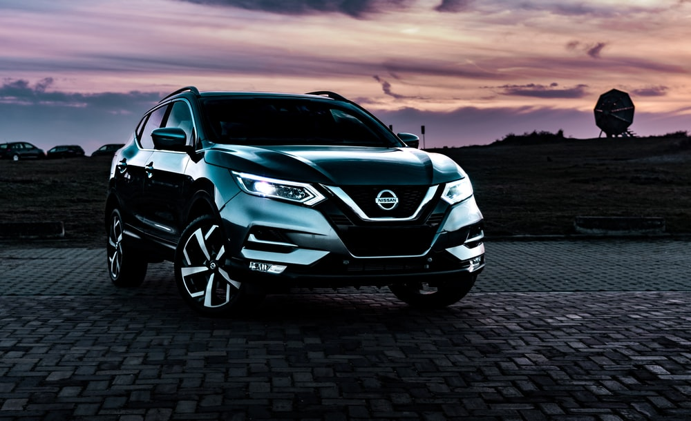 gray Nissan Rogue SUV outdoor during nighttime