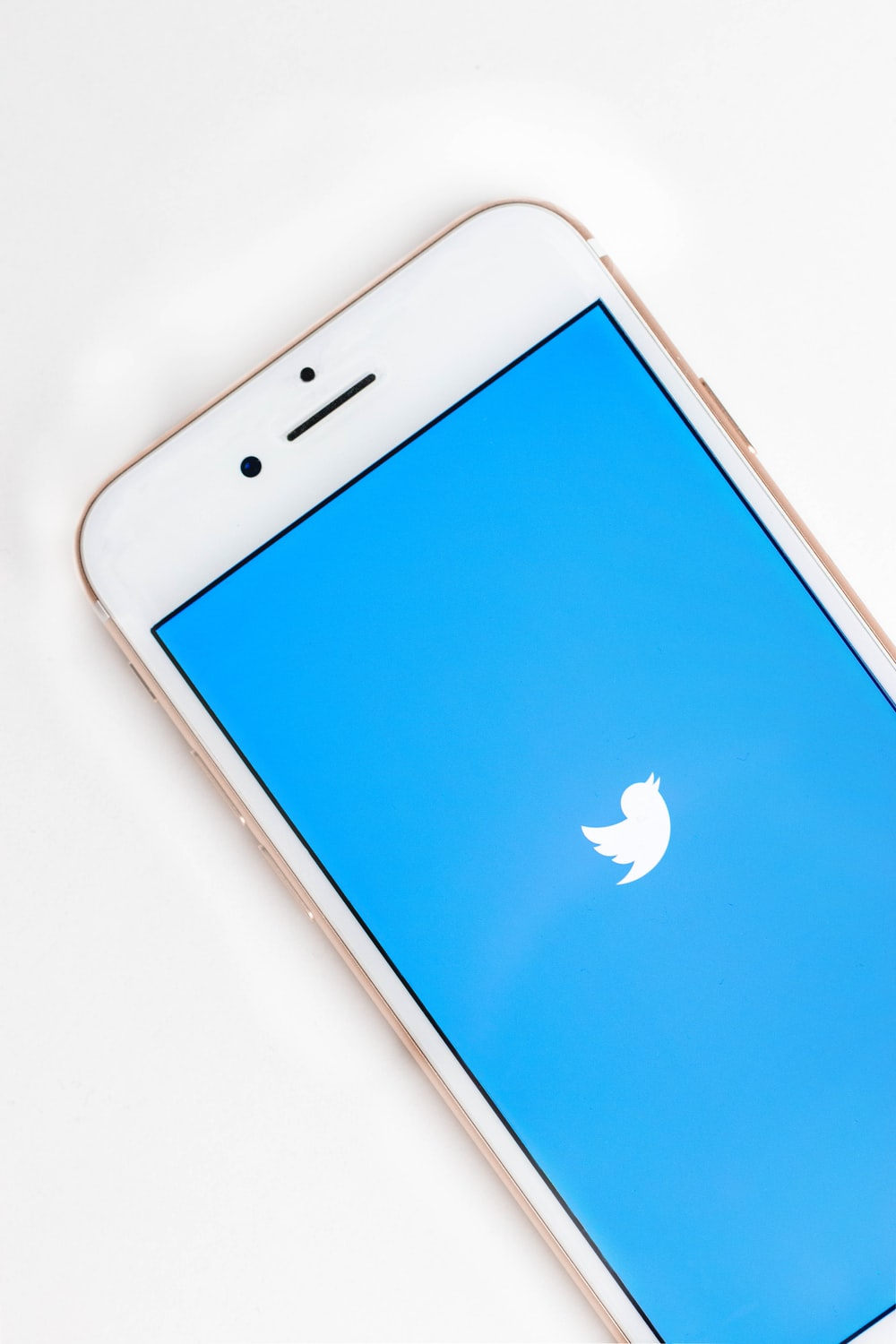 gold Apple iPhone 6s displaying Twitter logo