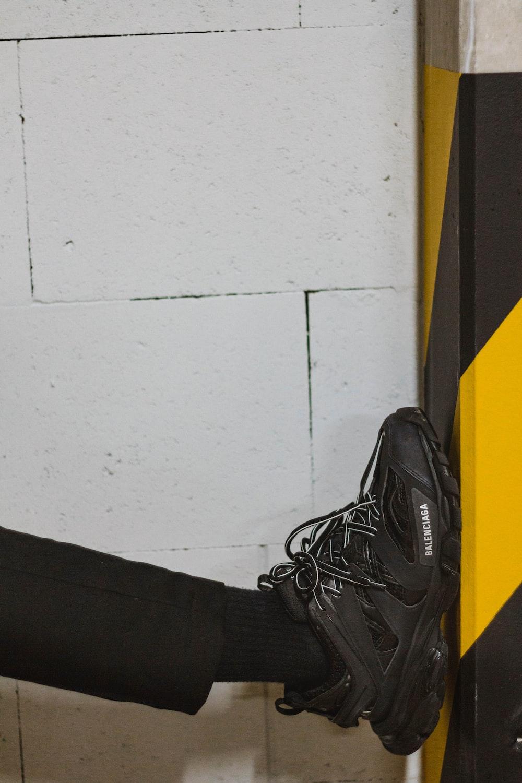 unpaired black shoe