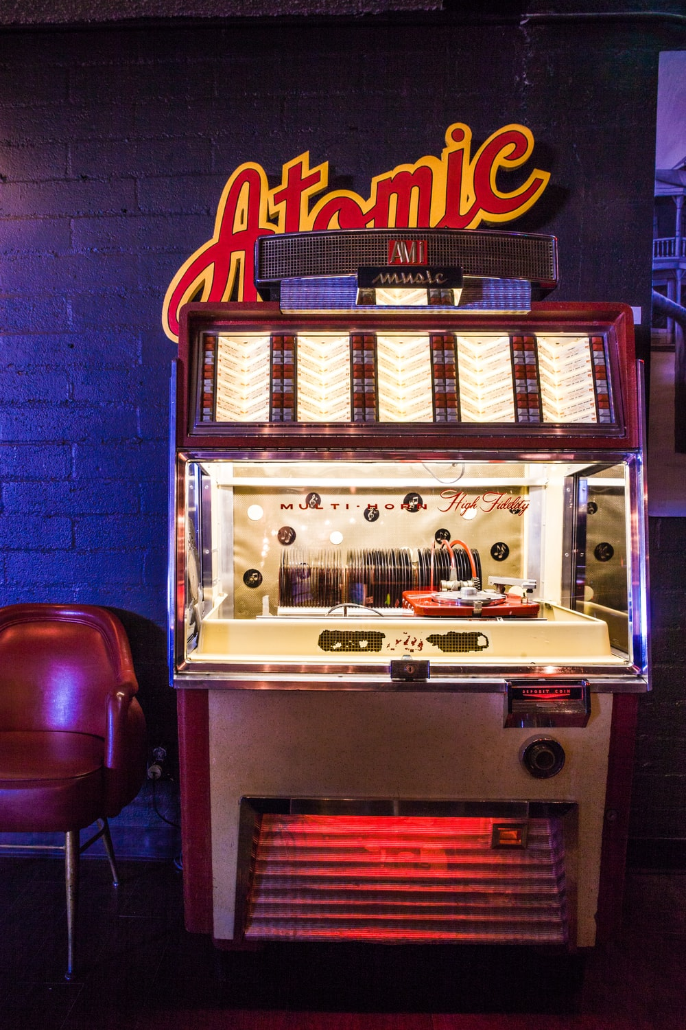 lighted brown and white arcade game console near wall