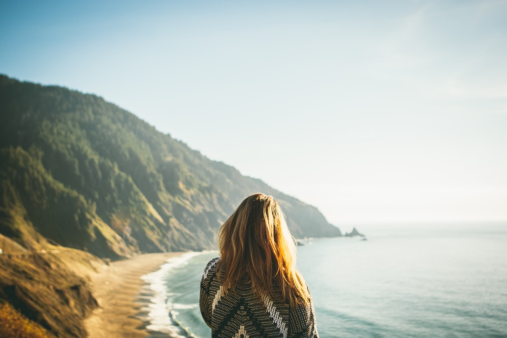 woman standing in front of sea