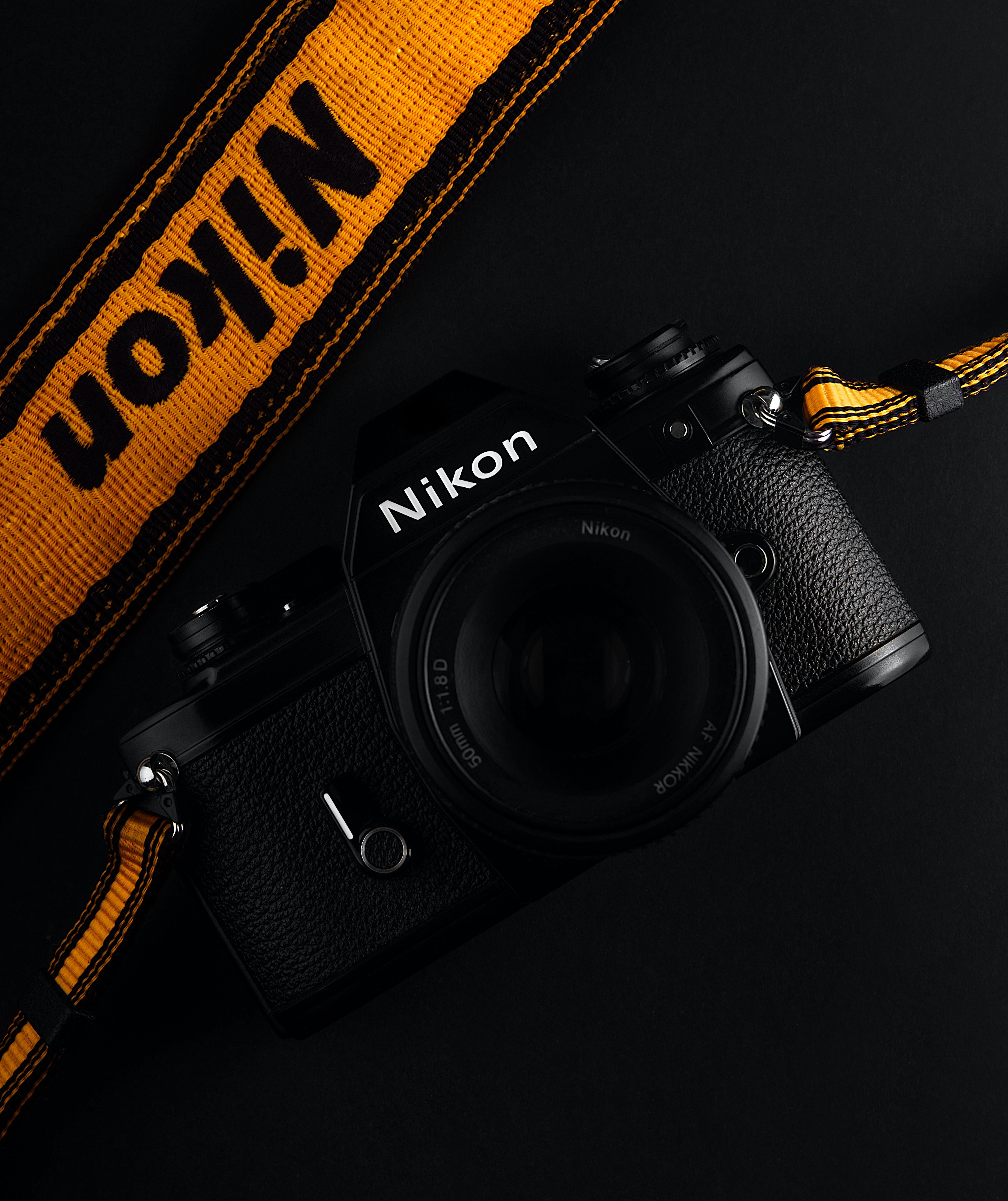 black Nikon body camera