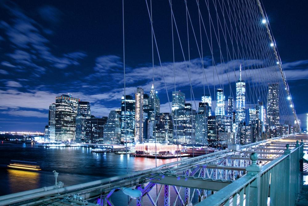 panoramic photo of buildings through bridge cables