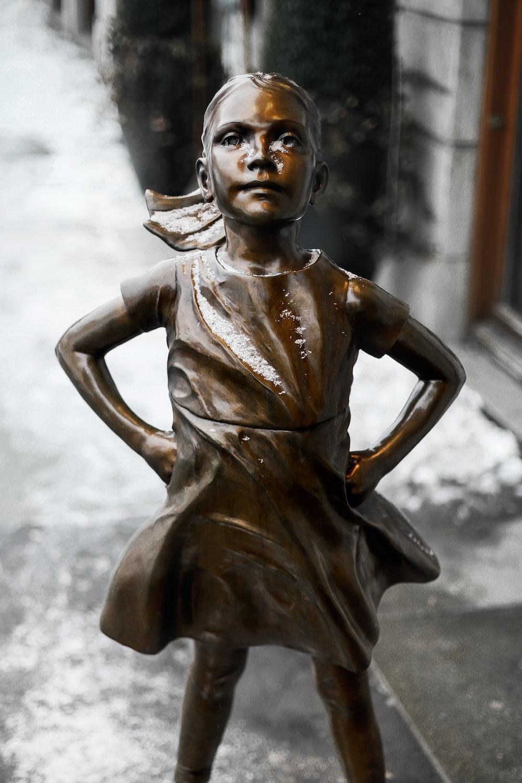 girl wearing dress figurine