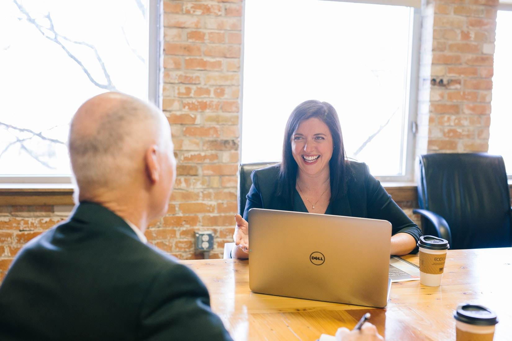 Female advisor smiling with laptop