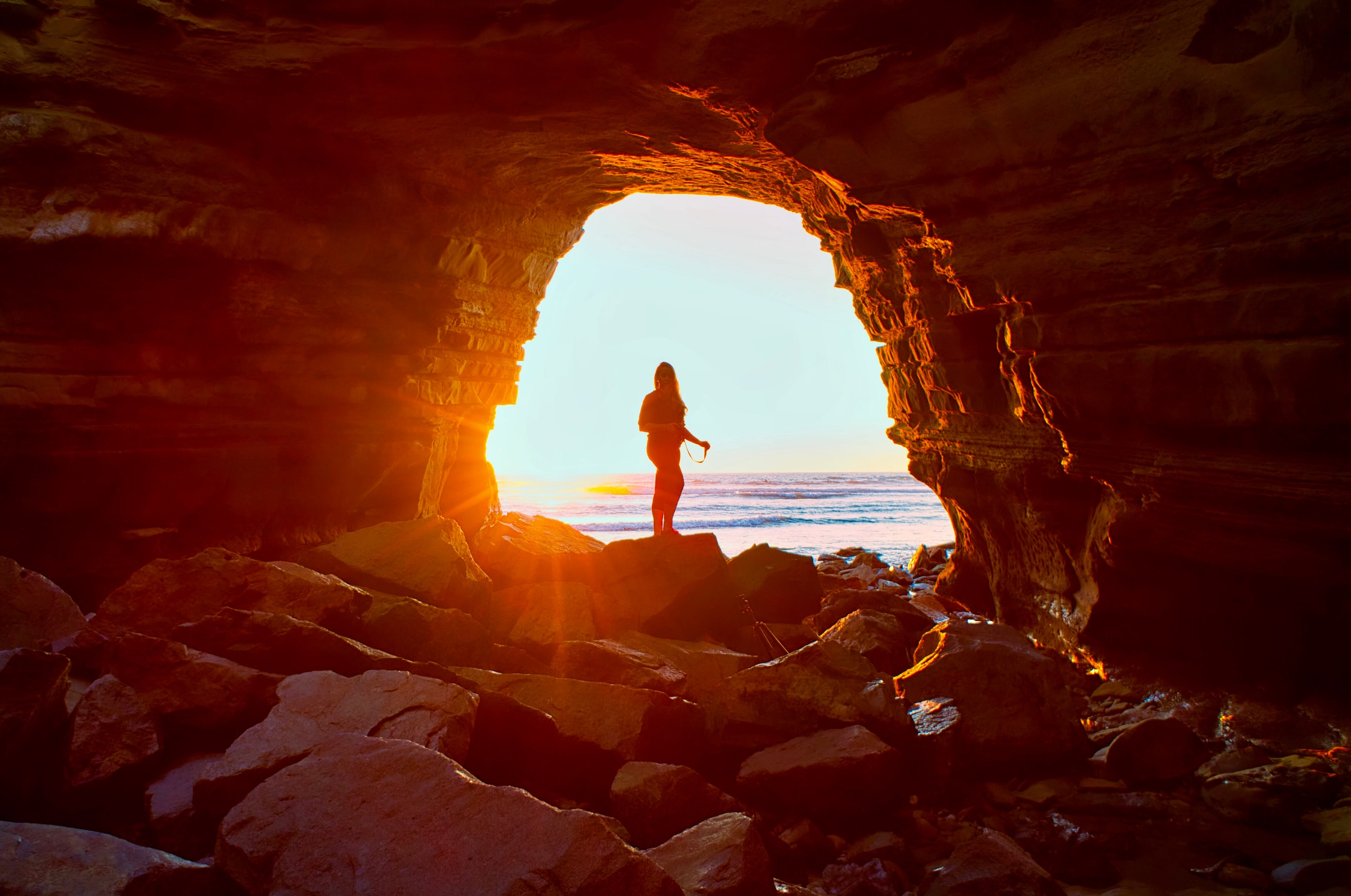 silhouette of woman in cave