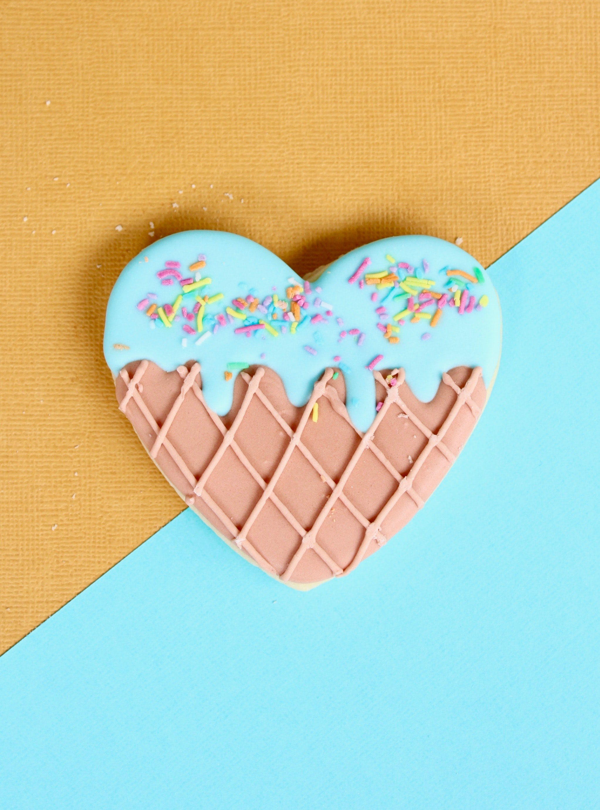 pink and blue icing coated doughnut