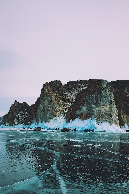 mountain cliff beside beach