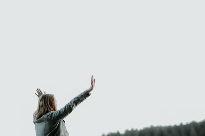 woman raising her hands christian teams background