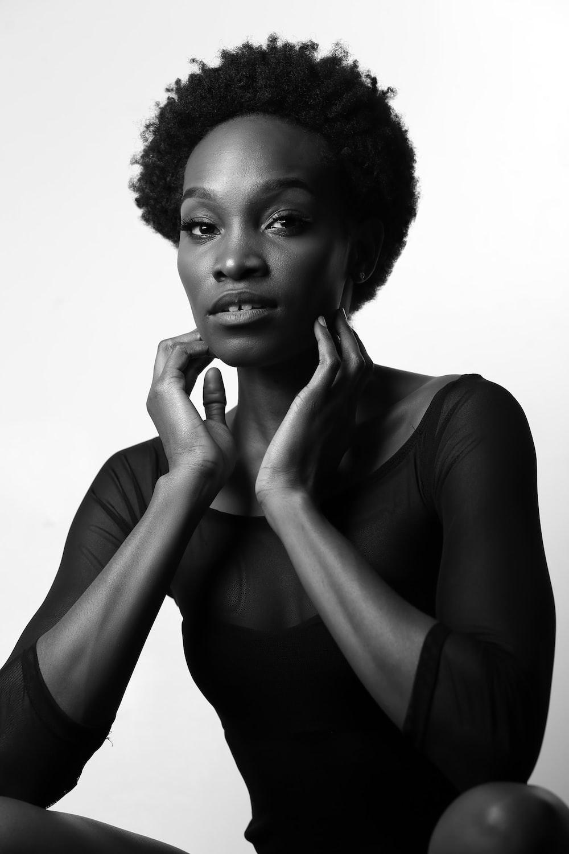 woman wearing black scoop-neck dress