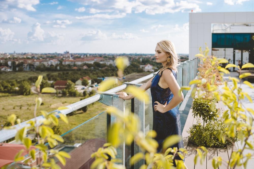 woman holding on glass balustrade