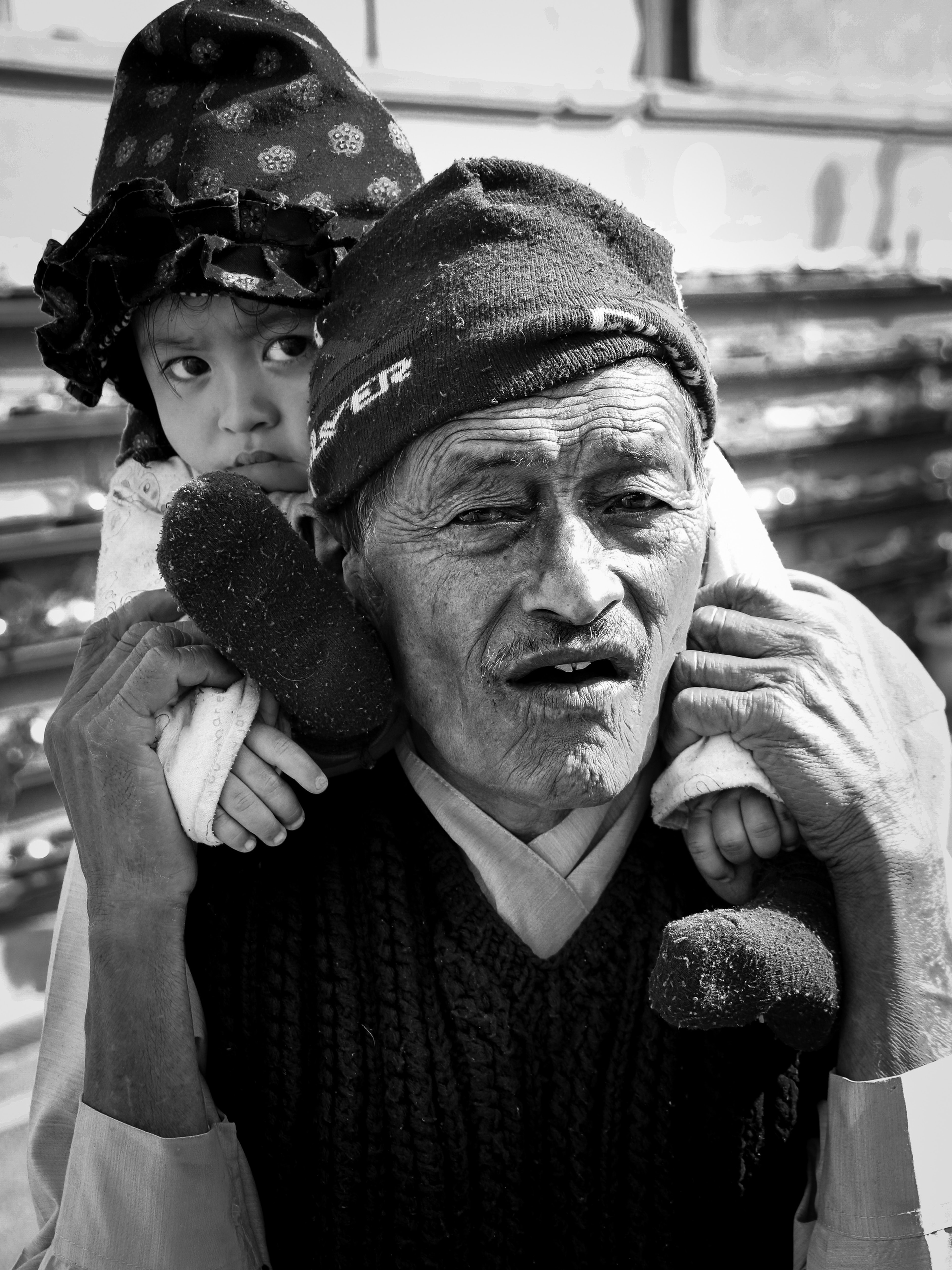man carrying girl in selective focus photography