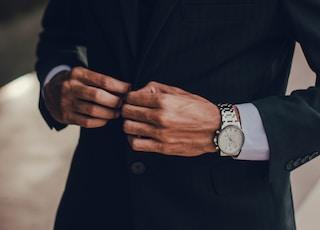 man wearing notched lapel suit jacket