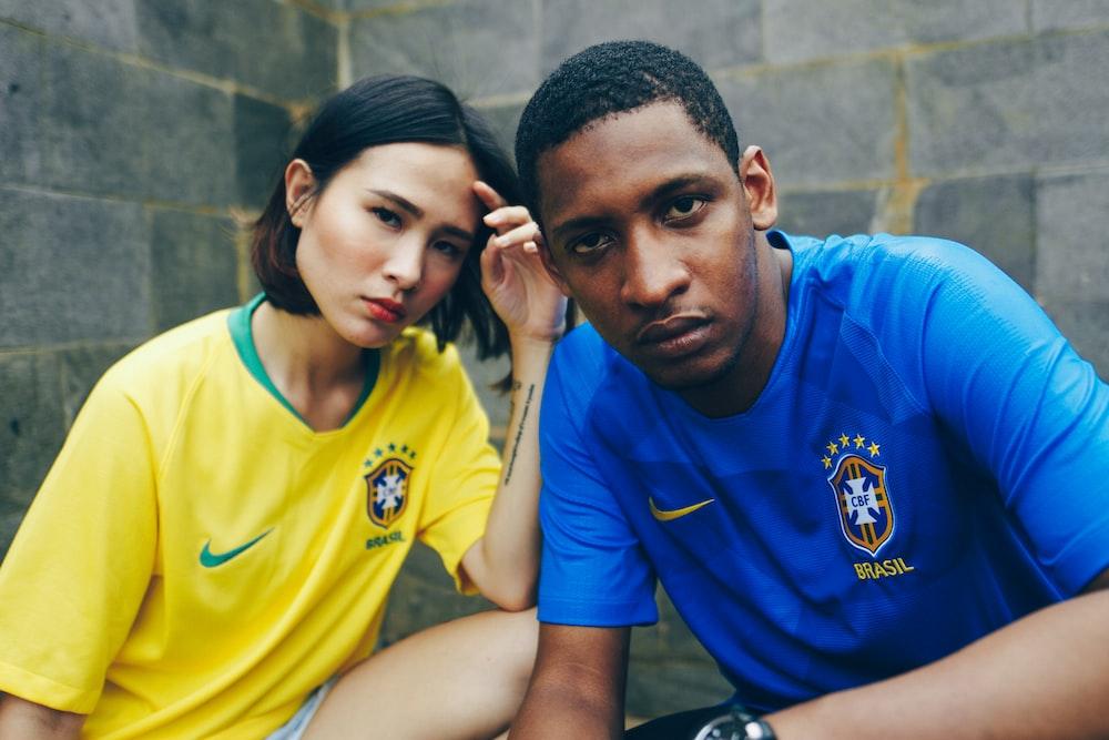 photo of man and woman wearing shirts