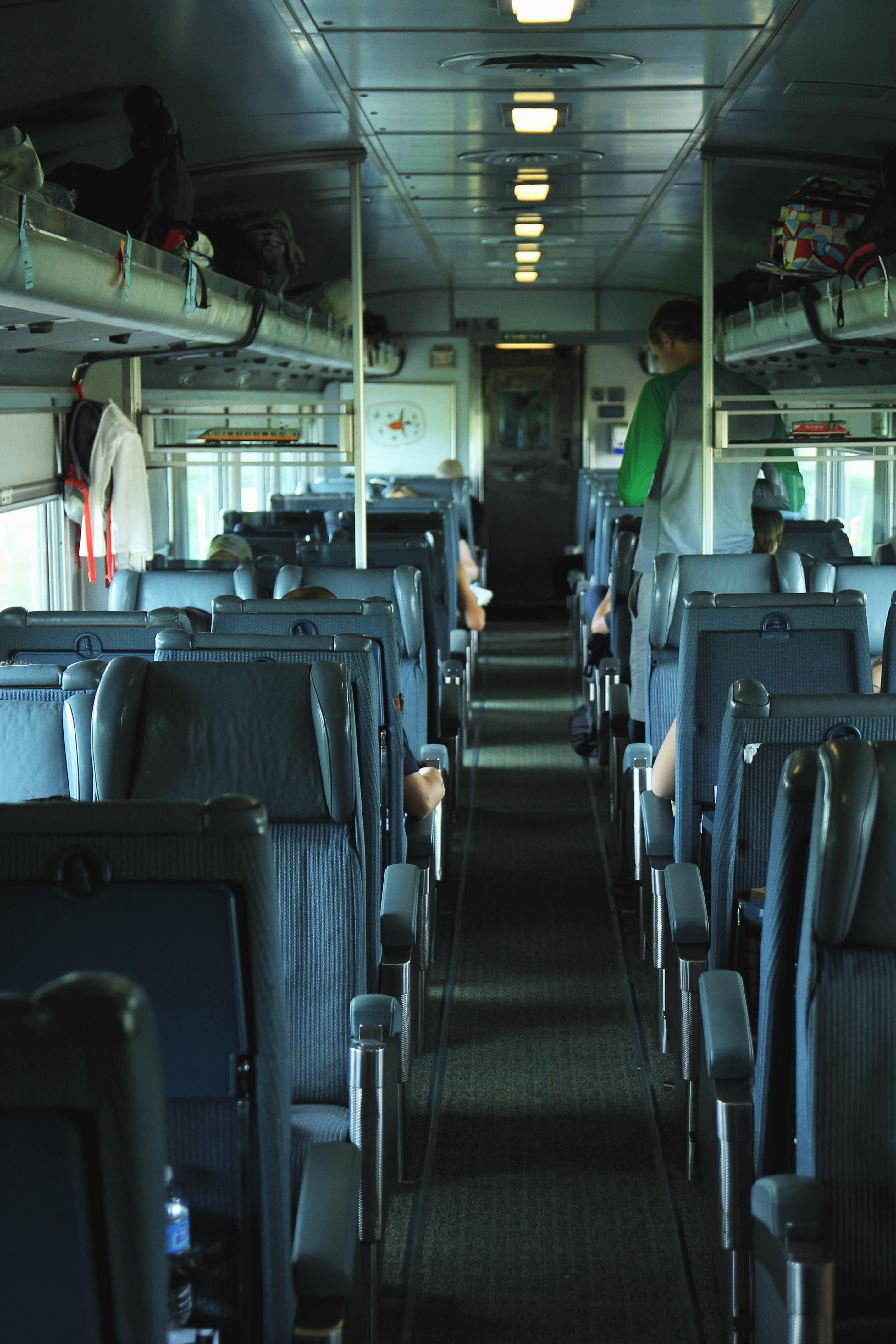 man standing in bus