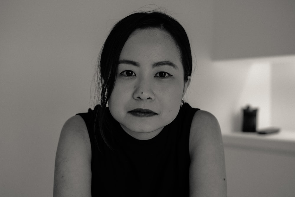 grayscale photography of woman in sleeveless top
