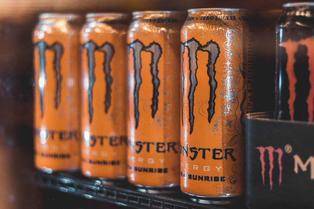 five Monster Energy cans