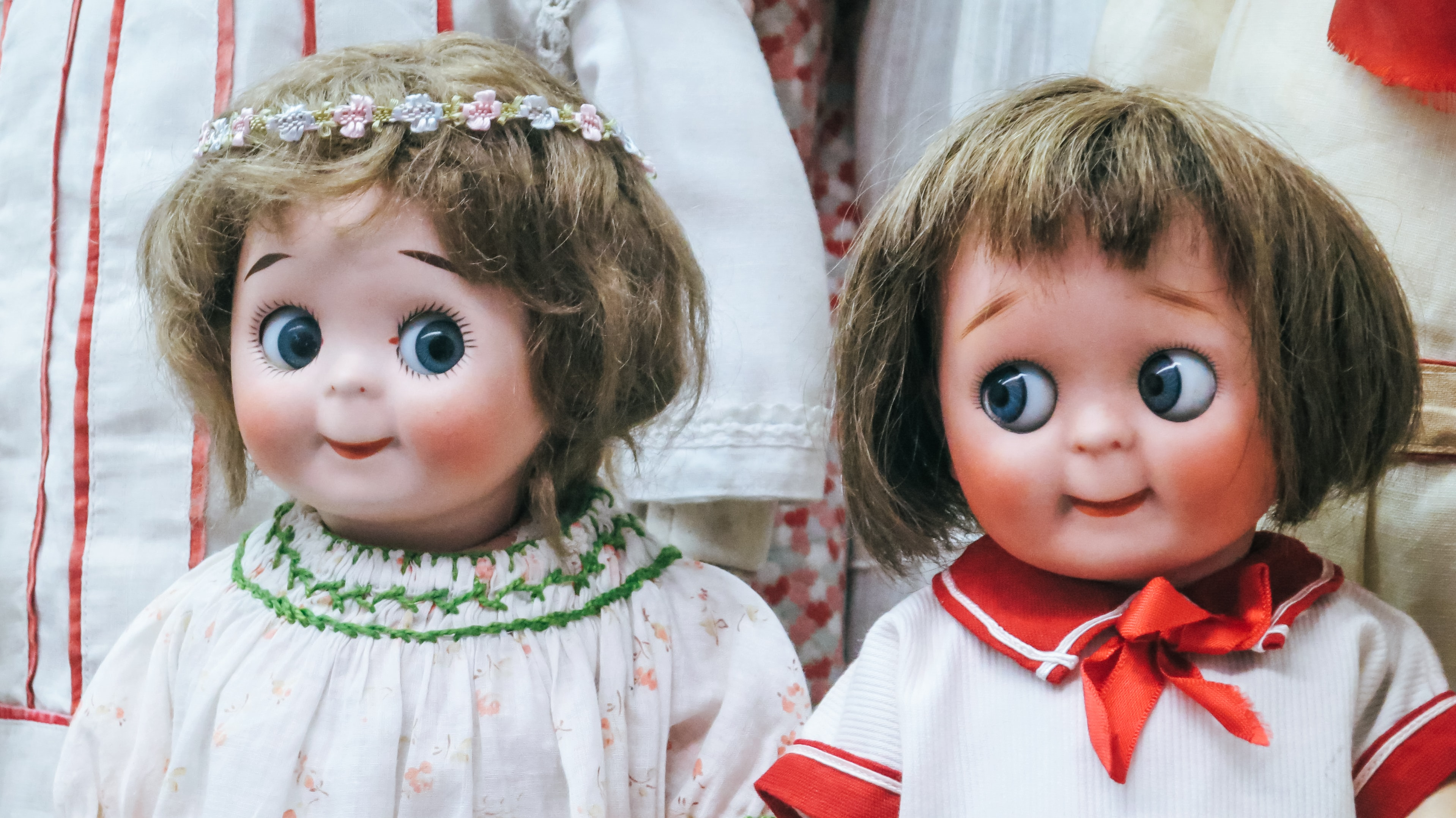 two female doll wearing white tops