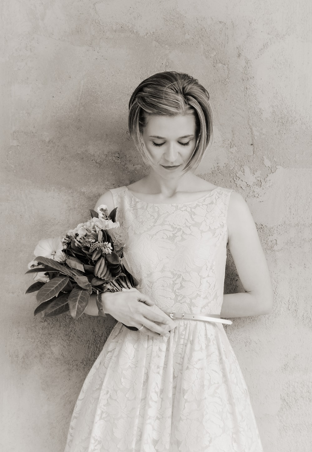 woman in floral dress holding bouquet of flower