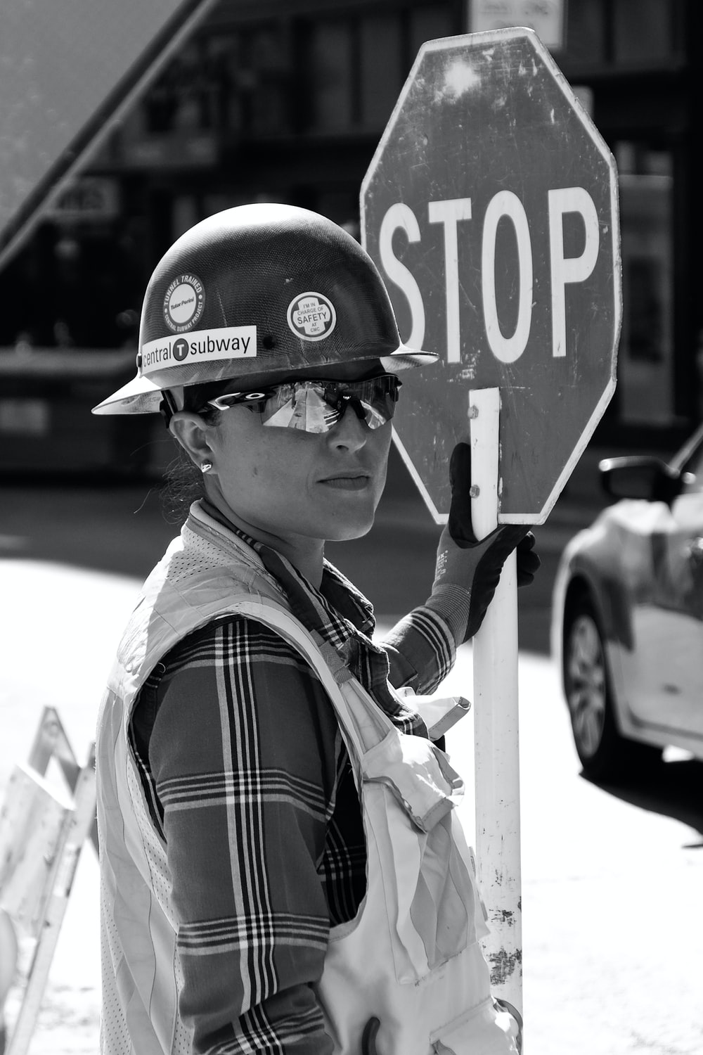 woman standing near the stop signage