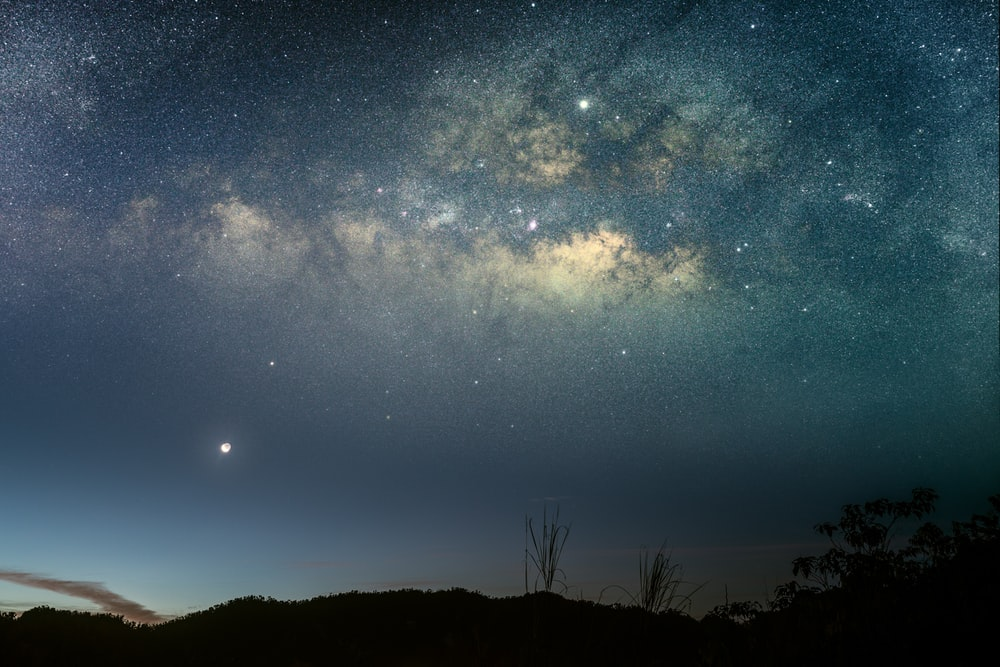 silhouette photo of mountain under starry night