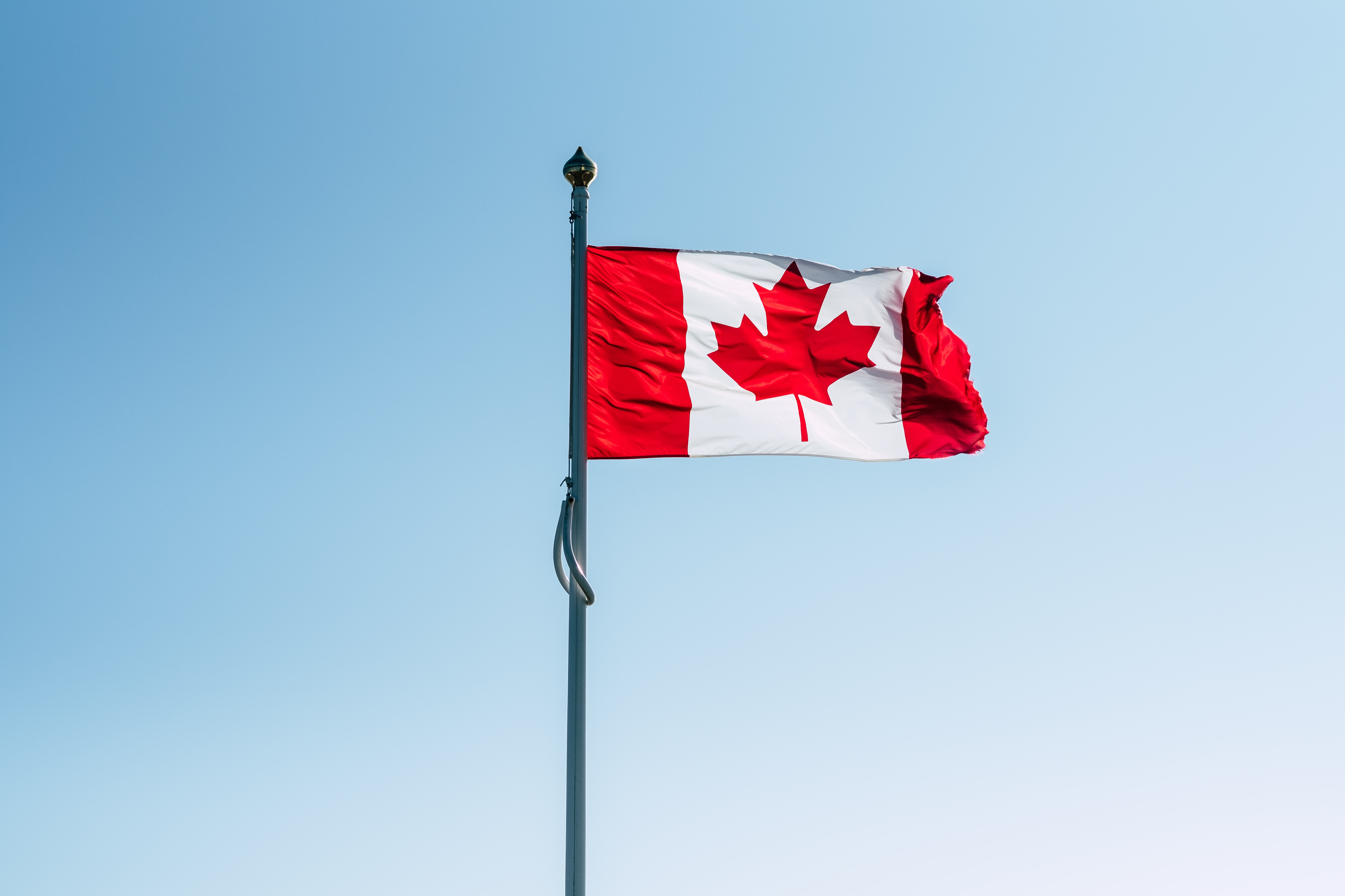 Canada flag on pole during daytime