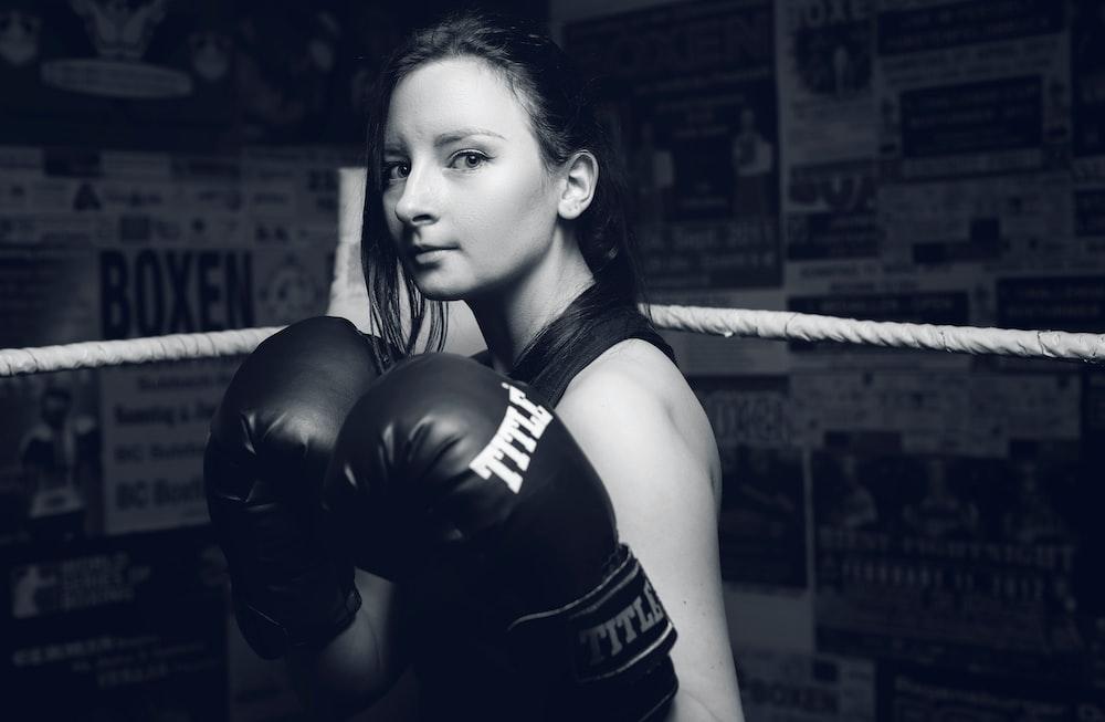 woman wearing black boxing gloves