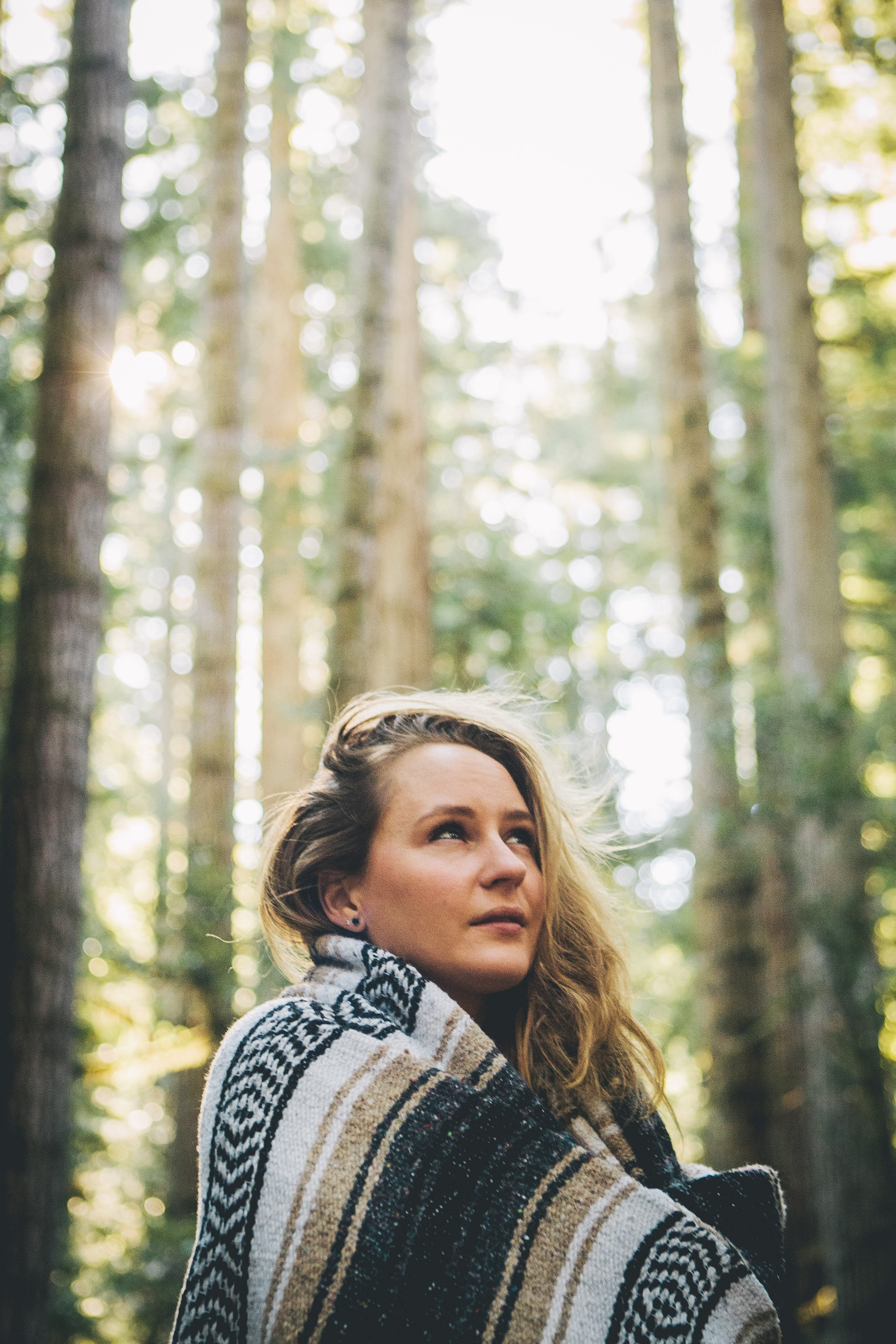 selective focus photography of woman at forest