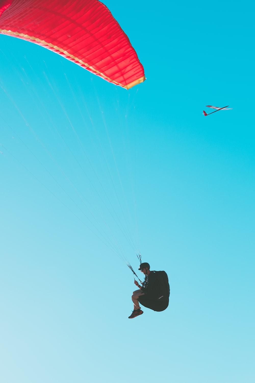person parachuting at daytime