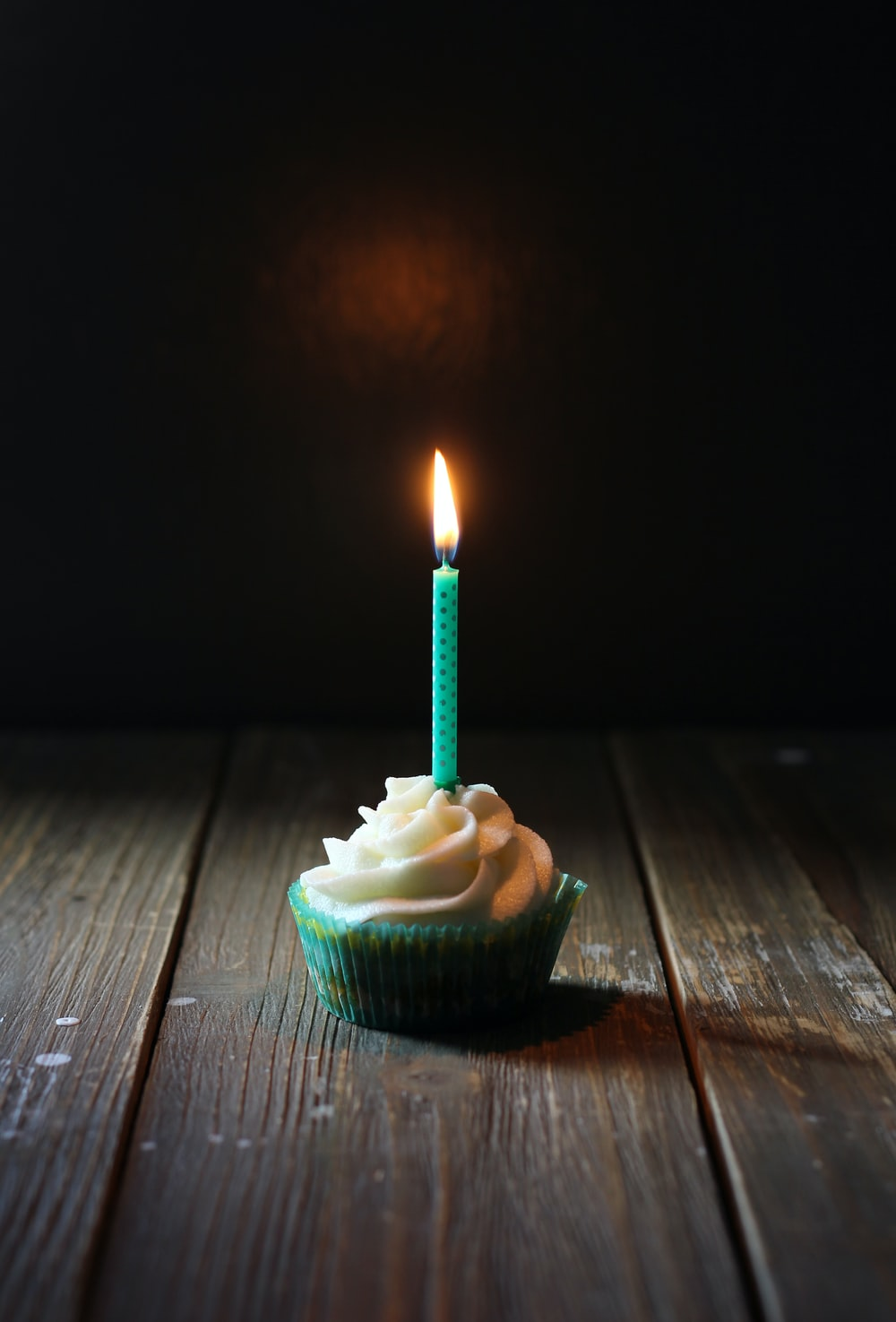 taper candle on cupcake