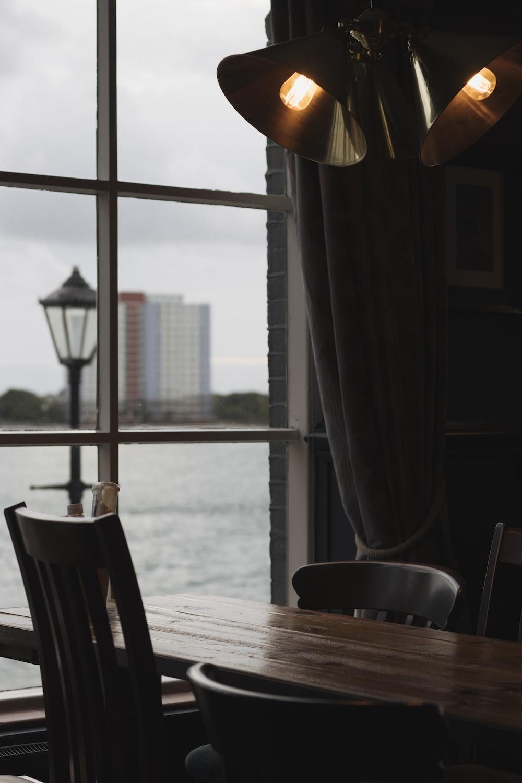 vacant chairs near window