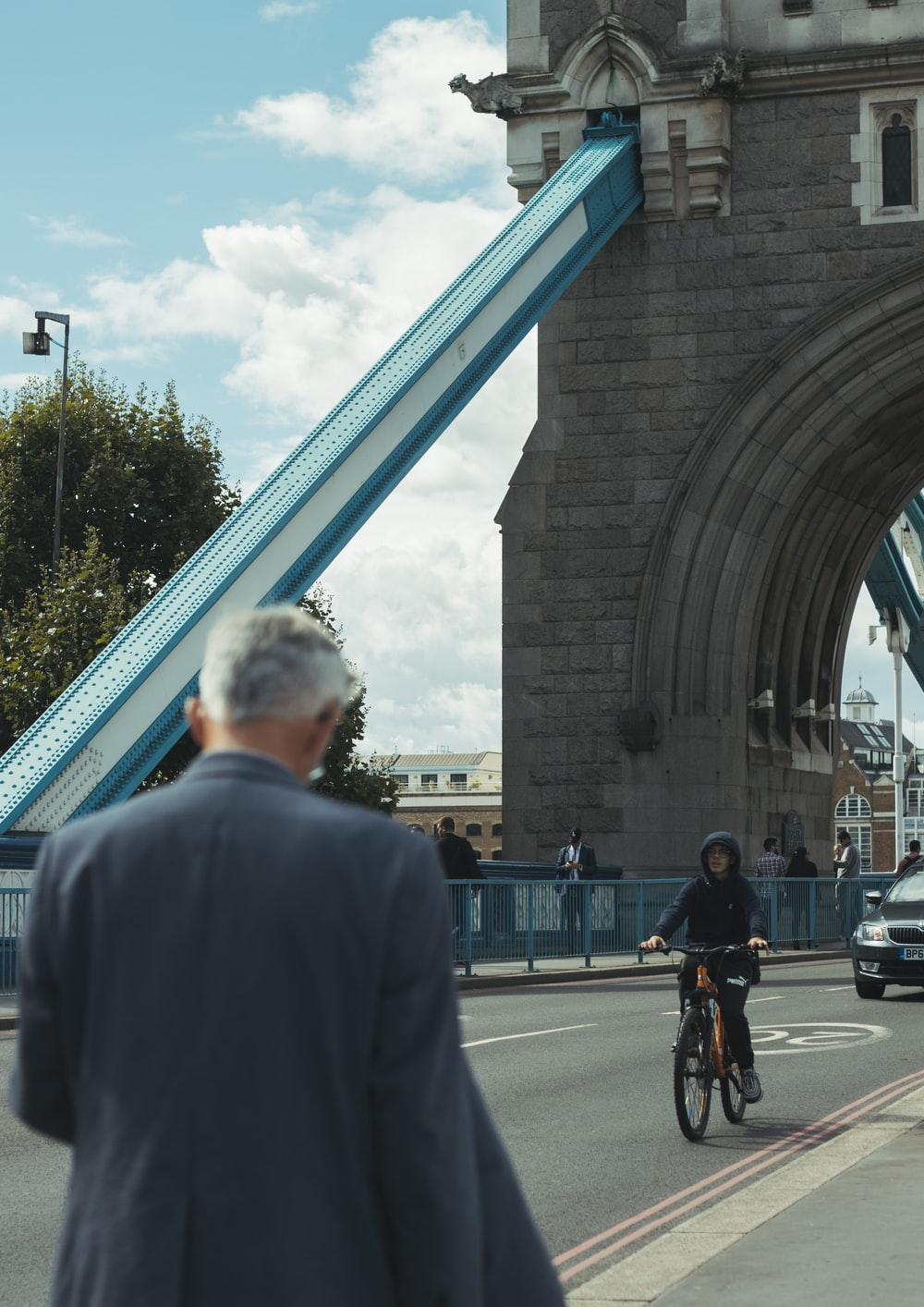 person biking on road during daytime