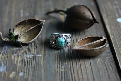 silver ring on brown surface