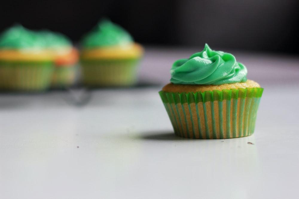 green cupcake selective photography