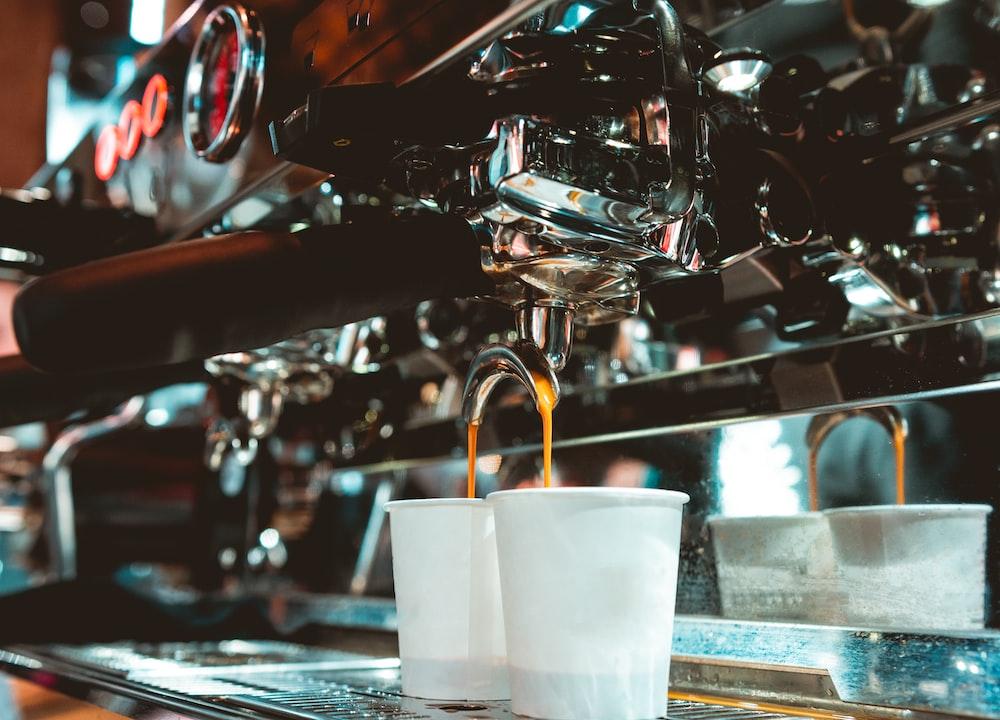 white cups in espresso maker