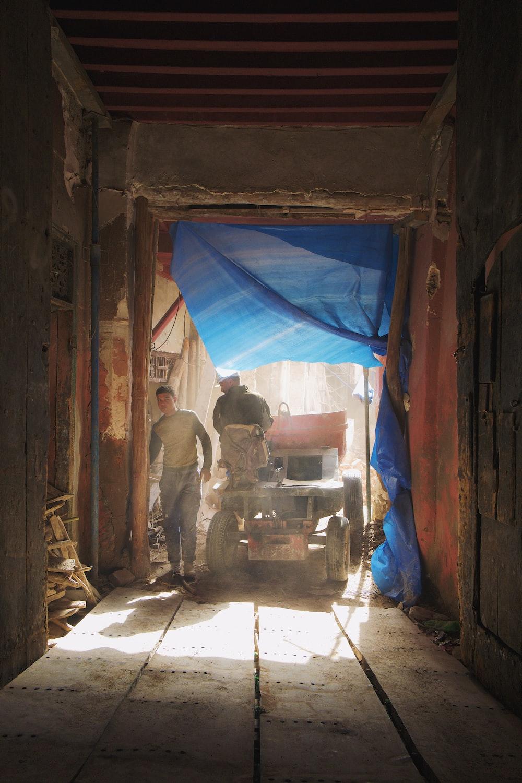 man riding vehicle inside tunnel