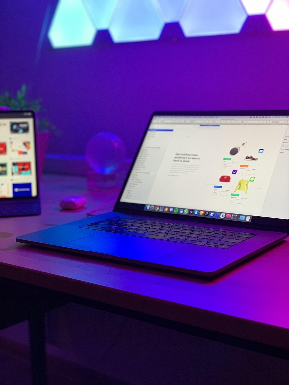 turned-on laptop on desk