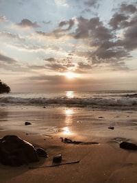 silhouette of rocks on seashore during daytime