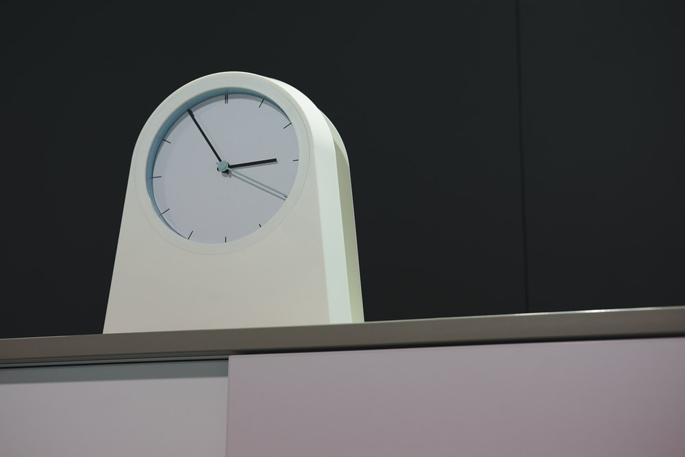 arched white analog clock