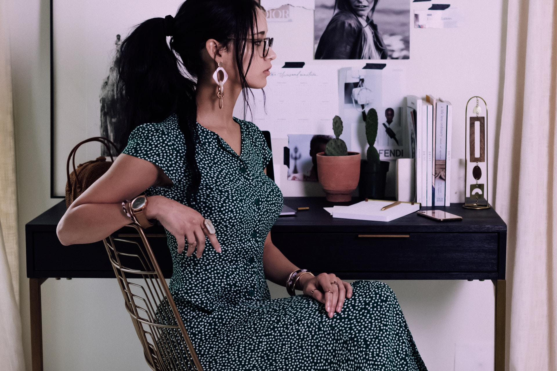 woman sitting on chair with cross legs